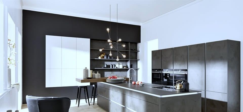 Designküche in Inselform mit Naturstein - Marquardt Küchen